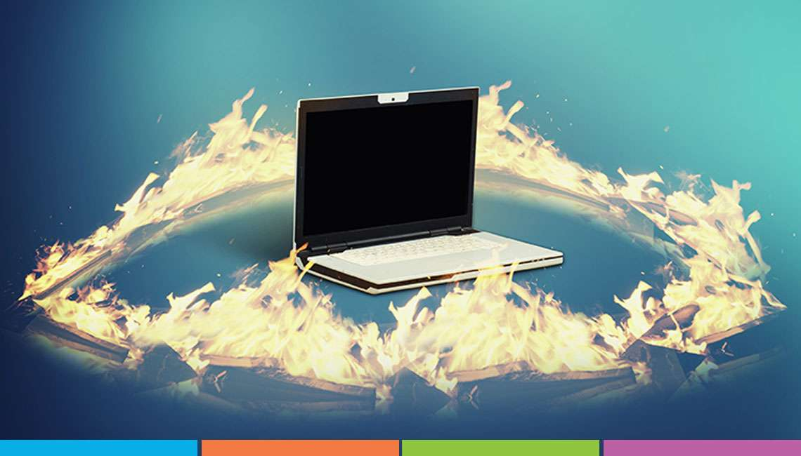Laptop with fire surrounding it.