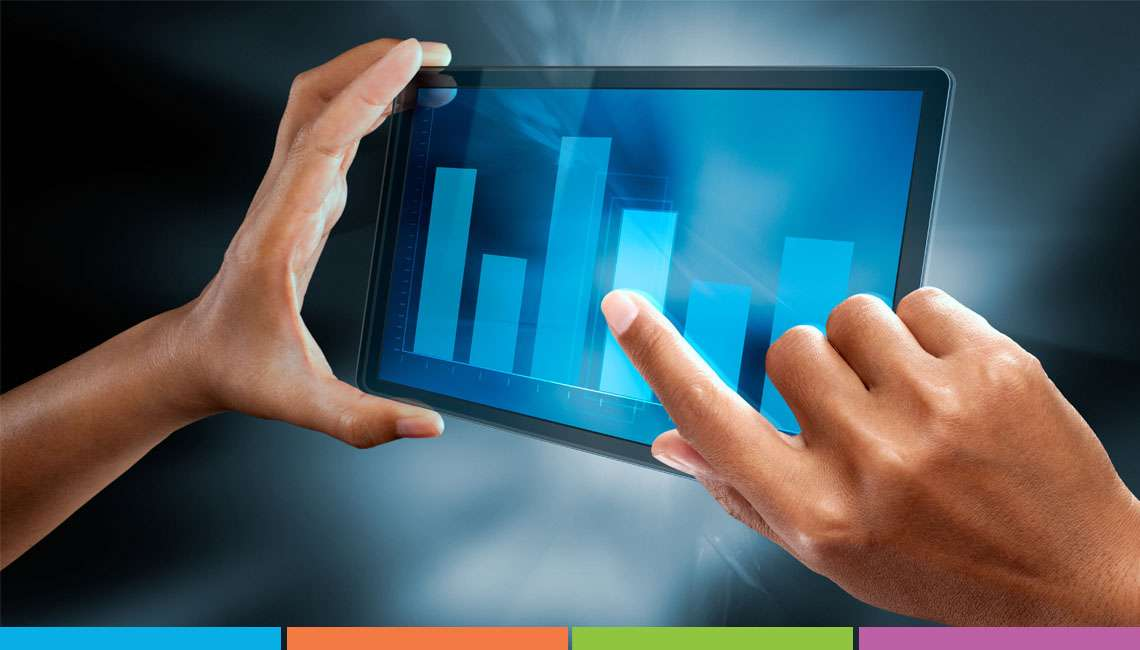 person touching bar chart on electronic tablet