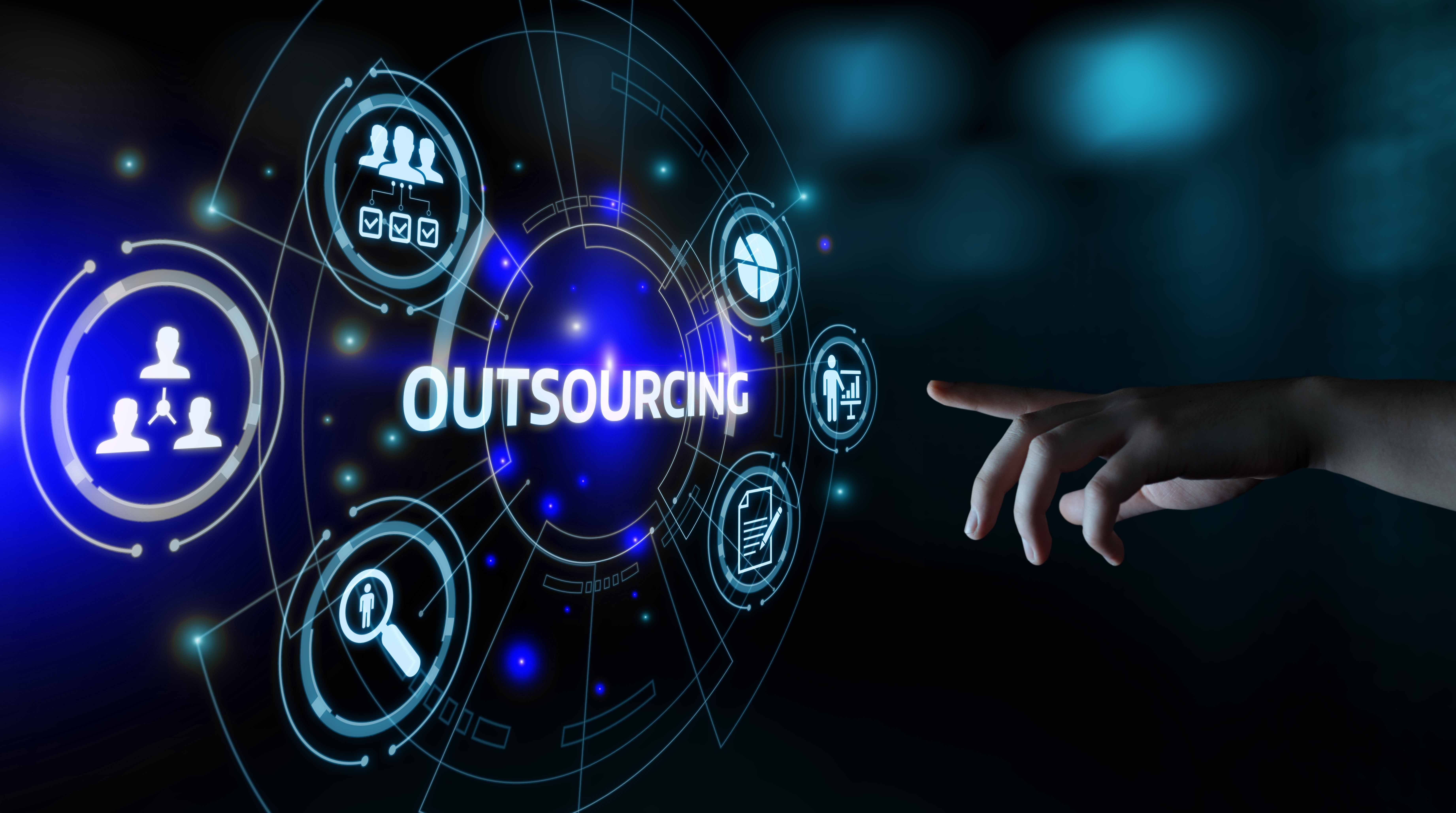 hand reaching out towards electronic 'outsourcing' icons